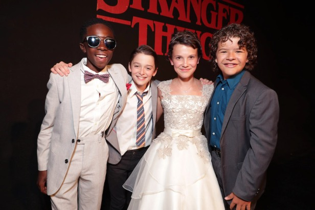 """Caleb McLaughlin, Noah Schnapp, Millie Brown, Gaten Matarazzo seen at the red carpet premiere in support of the launch of the Netflix original series """"Stranger Things"""" at Mack Sennett Studios on Monday, July 11, 2016, in Los Angeles, CA. (Photo by Eric Charbonneau/Invision for Netflix/AP Images)"""